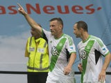 Wolfsburg's Croatian striker Ivica Olic and Wolfsburg's Czech midfielder Jan Polak celebrate scoring during the German first division Bundesliga football match Wolfsburg vs Hertha Berlin in Wolfsburg on August 31, 2013