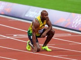 Asafa Powell of Jamaica looks on after the Men's 100m Final on Day 9 of the London 2012 Olympic Games at the Olympic Stadium on August 5, 2012