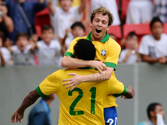 Brazil's Jo celebrates his goal against Australia with teammate Bernard, during their friendly football match at the Mane Garrincha National stadium, in Brasilia, Brazil, on September 7, 2013