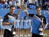 US brothers Bob and Mike Bryan pose with the trophy after winning the ATP Aegon Championships final doubles tennis match against French pair, Michael Llodra and Nicolas Mahut, at the Queen's Club in west London on June 16, 2013