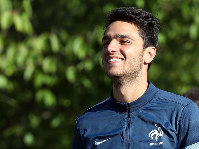 French national football team midfielder Clement Grenier arrives for a training session in Clairefontaine-en-Yvelines, outside Paris on September 2, 2013