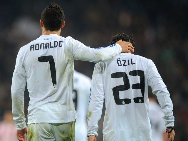 Cristiano Ronaldo and Mesut Ozil celebrate a goal scored by the former.