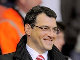 Liverpool Director of Sports Strategy Damien Comolli looks on prior to the Barclays Premier League match between Liverpool and Manchester City at Anfield on April 11, 2011