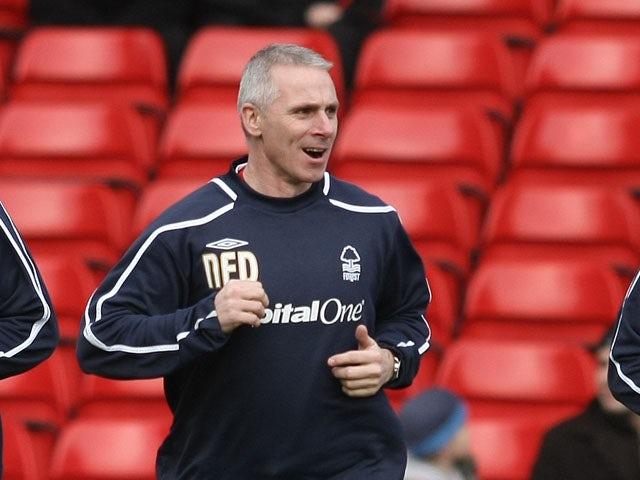 Nottingham Forest assistant manager David Kelly joins Wes Morgan and Luke Chambers in the pre match warm up proir to the Coca Cola Championship match between Nottingham Forest and Plymouth Argyle at the City Ground on January 17, 2009