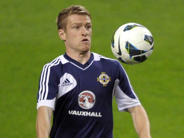 Northern Ireland's Dean Shiels warms up in Portugal on October 15, 2012