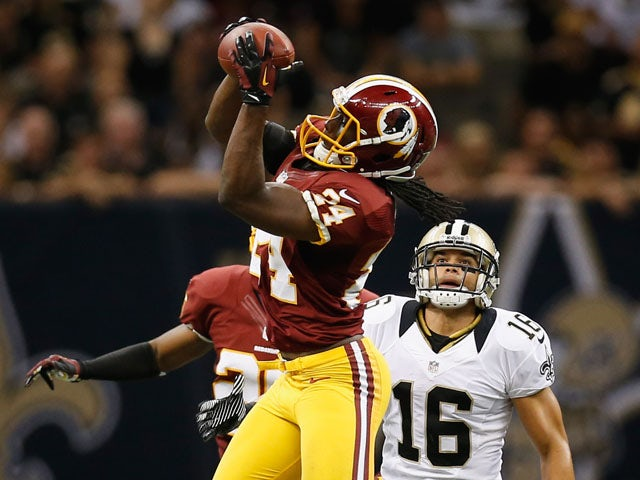 DeJon Gomes #24 of the Washington Redskins intercepts a ball over Lance Moore #16 of the New Orleans Saints during the season opener at Mercedes-Benz Superdome on September 9, 2012