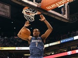 Minnesota Timberwolves' Derrick Williams slam dunks the ball against Phoenix Suns on March 12, 2012