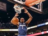 Minnesota Timberwolves' Derrick Williams slam dunks the ball against Phoenix Suns on March 12, 2012