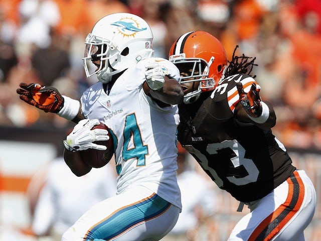 Miami's Dimitri Patterson fends off Trent Richardson of Cleveland during a game on September 8, 2013