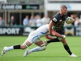 Dylan Hartley of Northampton Saints is tackled by Thom Johnson of Exeter Chiefs during the Aviva Premiership match between Northampton Saints and Exeter Chiefs at Franklin's Gardens on September 7, 2013