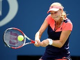 Ekaterina Makarova of Russia plays a backhand during her women's singles quarter-final match against Na Li of China on Day Nine of the 2013 US Open at USTA Billie Jean King National Tennis Center on September 3, 2013