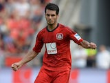 Leverkusen's Bosnian defender Emir Spahic in action during the German first division Bundesliga match between Bayer 04 Leverkusen and SC Freiburg in the stadium in Leverkusen, Germany, on August 10, 2013