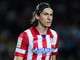 Filipe Luis of Atletico de Madrid looks on during the Spanish Super Cup second leg match between FC Barcelona and Atletico de Madrid at Nou Camp on August 28, 2013