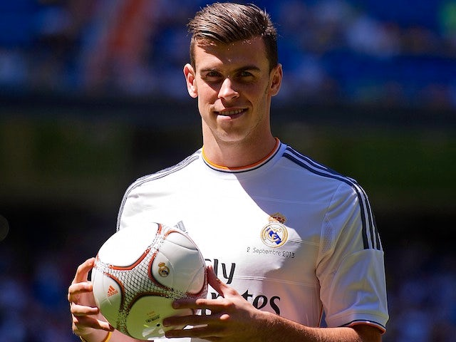 Gareth Bale poses as a Real Madrid player at the Bernabeu on September 2, 2013