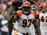 Geno Atkins #97 of the Cincinnati Bengals celebrates after he sacked T.J. Yates #13 of the Houston Texans in the first half during their 2012 AFC Wild Card Playoff game at Reliant Stadium on January 7, 2012