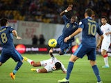 France's midfielder Moussa Sissoko is tackled by Georgia's midfielder Tornike Okriachvili during the FIFA World Cup 2014 qualifying football match Georgia vs France on September 6 2013