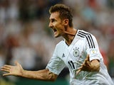 Germany's striker Miroslav Klose celebrates after scoring the 1-0 during the FIFA World Cup 2014 group C qualifying football match of Germany vs Austria on September 6, 2013