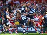 Jonathan Mills of Sale Sharks is upended catching a high ball during the Aviva Premiership match between Gloucester and Sale Sharks at Kingsholm Stadium on September 7, 2013