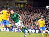 Sweden's Johan Elmander scores a goal past Republic of Ireland defender Richard Dunne during the World Cup 2014 European zone group C qualifying football match between Republic of Ireland and Sweden at the Aviva Stadium in Dublin, Ireland, on September 6,