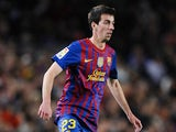 Isaac Cuenca of FC Barcelona runs with the ball during the La Liga match between FC Barcelona and Getafe CF at Camp Nou on April 10, 2012