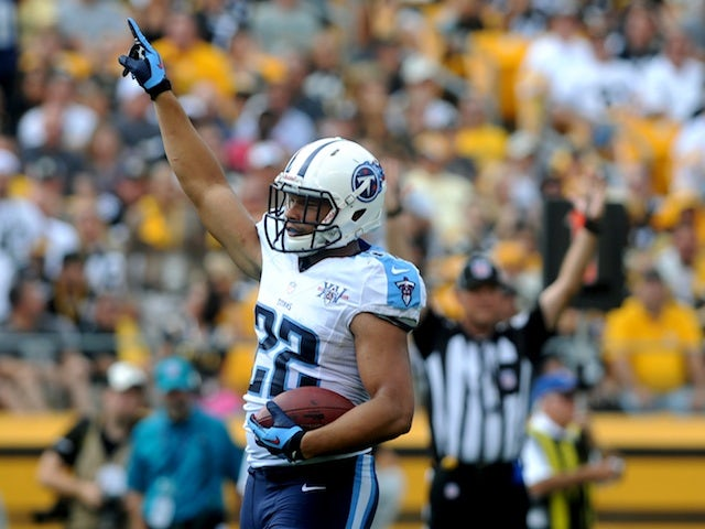 Titans' Jackie Battle celebrates scoring against Pittsburgh on September 8, 2013