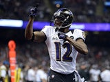 Jacoby Jones #12 of the Baltimore Ravens reacts against the San Francisco 49ers during Super Bowl XLVII at the Mercedes-Benz Superdome on February 3, 2013