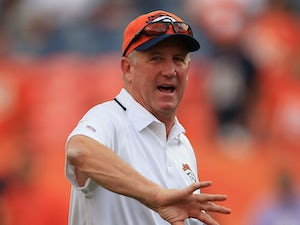 Head coach John Fox of the Denver Broncos watches his team warm up prior to the game against the Baltimore Ravens during the game at Sports Authority Field at Mile High on September 5, 2013