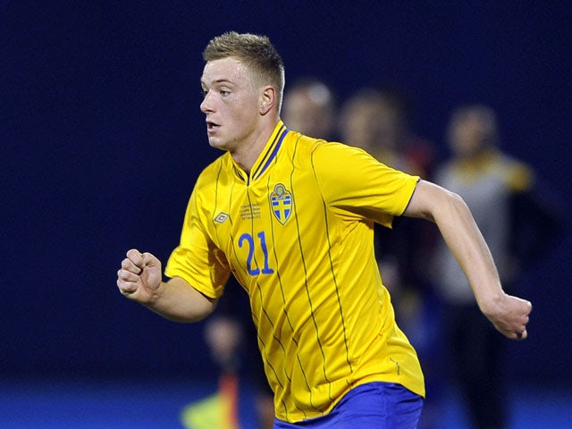 Sweden's John Guidetti prepares to shoot the ball during the friendly football match between Croatia and Sweden in Zagreb on February 29, 2012