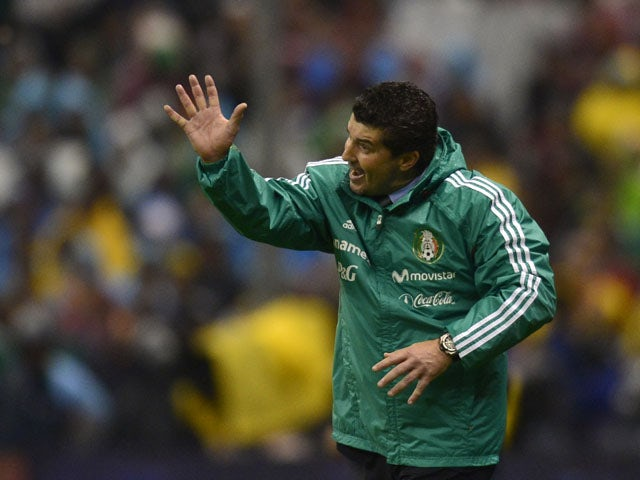 Mexico's coach Jose Manuel de la Torre gestures during their Brazil 2014 FIFA World Cup CONCACAF qualifier match against Honduras, at the Azteca Stadium in Mexico City, on September 6, 2013