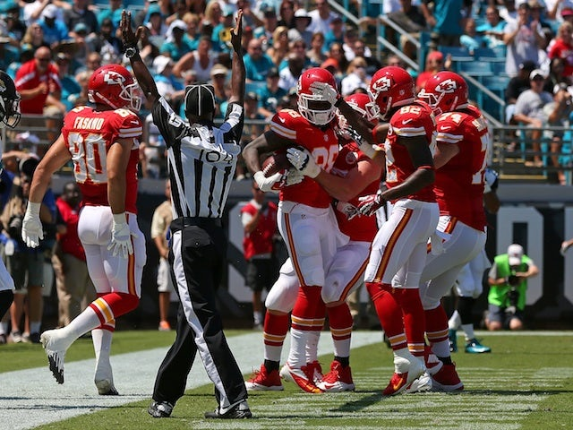 Chiefs players congratulate Junior Hemingway following a touchdown against Jacksonville on September 8, 2013