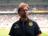 Dortmund's head coach Jurgen Klopp gives interviews prior to the Telekom Cup football match Borussia Moenchengladbach vs Borussia Dortmund in the German city of Moenchengladbach on July 20, 2013