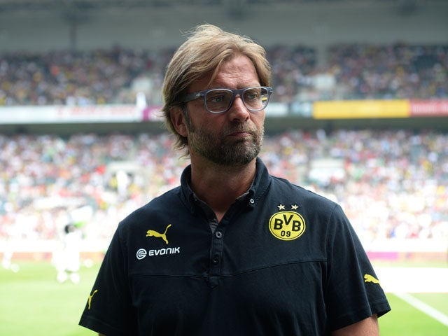 Dortmund's head coach Jurgen Klopp gives interviews prior to the Telekom Cup football match Borussia Moenchengladbach vs Borussia Dortmund in the German city of Moenchengladbach on July 20, 2013