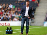MK Dons manager Karl Robinson looks on during the Pre-Season Friendly match between MK Dons and Tottenham Hotspur XI at Stadium mk on July 31, 2013