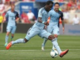 Kei Kamara #23 of Sporting Kansas City moves up the field against the Chicago Fire during an MLS match at Toyota Park on July 7, 2013