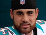 Koa Misi #55 of the Miami Dolphins standa in the tunnel prior to the game against Oakland Raiders at Sun Life Stadium on September 16, 2012