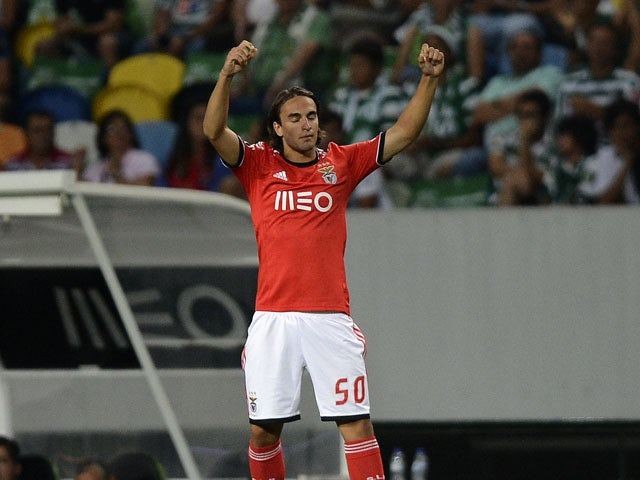 Benfica's Serb forward Lazar Markovic celebrates after his team scored the equalizer during the Portuguese league football match Sporting CP vs SL Benfica at the Jose Alvalade stadium in Lisbon on August 31, 2013