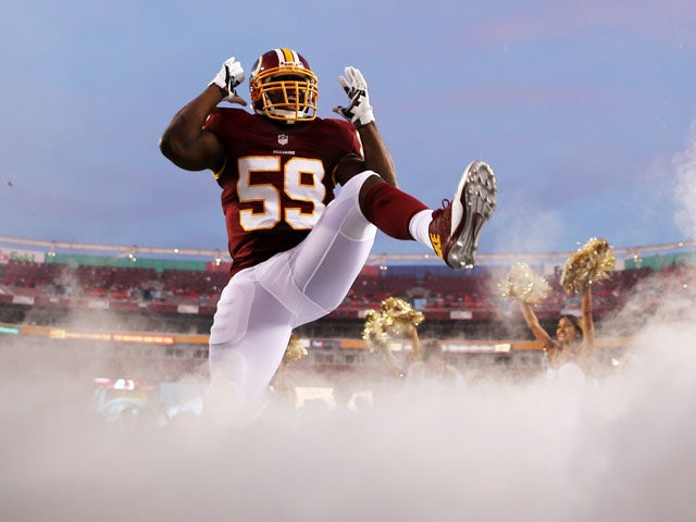Linebacker London Fletcher #59 of the Washington Redskins is introduced before the start of a preseason game against the Pittsburgh Steelers at FedExField on August 19, 2013