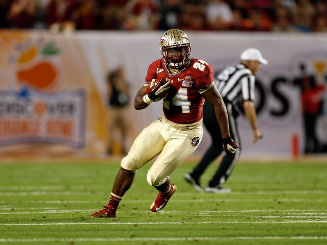 Lonnie Pryor #24 of the Florida State Seminoles runs the ball against the Northern Illinois Huskies during the Discover Orange Bowl at Sun Life Stadium on January 1, 2013