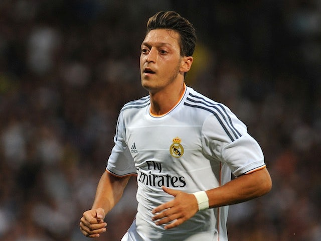 Mesut Ozil of Real Madrid looks on during the pre-season match between Lyon and Real Madrid on July 24, 2013