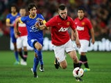Michael Keane of Manchester United controls the ball during the match between the A-League All-Stars and Manchester United at ANZ Stadium on July 20, 2013