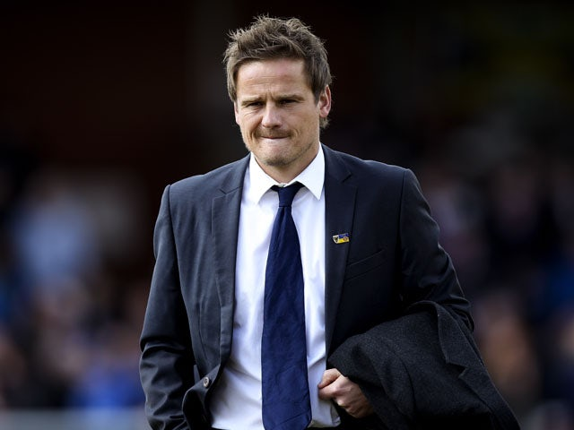 AFC Wimbledon manager Neal Ardley looks on prior to the npower League Two match between AFC Wimbledon and Fleetwood Town at the Cherry Red Records Stadium on April 27, 2013