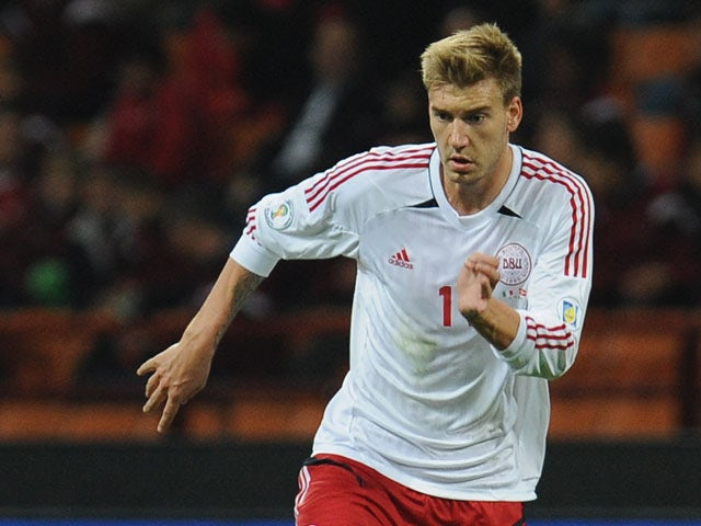 Nicklas Bendtner of Denmark in action during the FIFA 2014 World Cup qualifier match between Italy and Denmark at Stadio Giuseppe Meazza on October 16, 2012