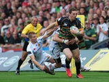 George North of Northampton Saints breaks through the Exeter Chiefs' defence during the Aviva Premiership match between Northampton Saints and Exeter Chiefs at Franklin's Gardens on September 7, 2013