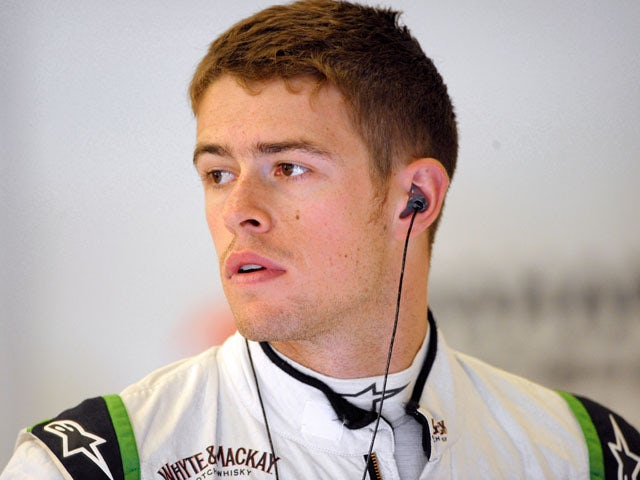 Force India's Scottish driver Paul di Resta stands in the pits during the first practice session at the Spa-Francorchamps circuit in Spa on August 23, 2013