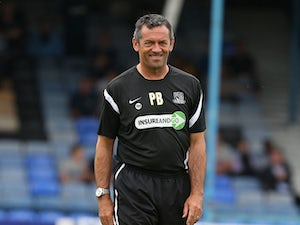 Southend United manager Phil Brown looks on as the players warm up prior to the Sky Bet League Two match between Southend United and Northampton Town at Roots Hall on August 17, 2013