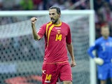 Montenegro's Dejan Demjanovic celebrates after scoring during the FIFA 2014 World Cup Qualifier between Poland and Montenegro at the National Stadium on September 06, 2013