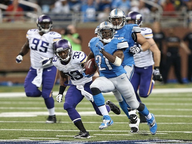 Lions' Reggie Bush runs in a 77 yard TD against Minnesota on September 8, 2013