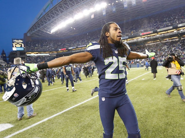 Cornerback Richard Sherman #25 of the Seattle Seahawks celebrates as he leaves the field after defeating the St. Louis Rams 20-13 at CenturyLink Field on December 30, 2012