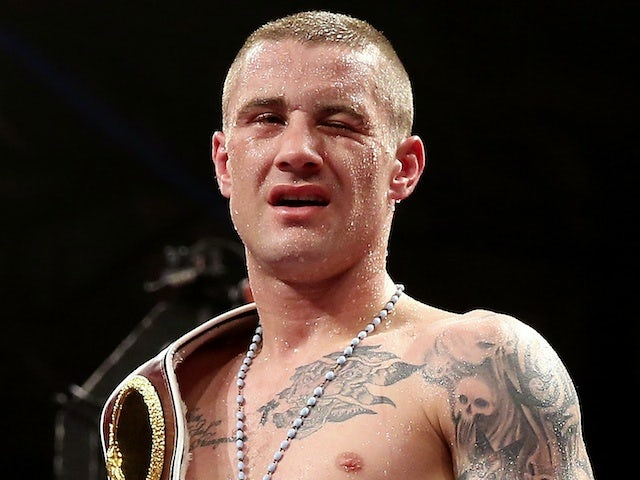Ricky Burns stands in the ring after his fight with Raymundo Beltran on September 7, 2013