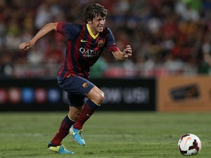 Sergi Roberto #24 of Barcelona makes a break against Thailand XI during the international friendly match between Thailand XI and FC Barcelona at Rajamangala Stadium on August 7, 2013